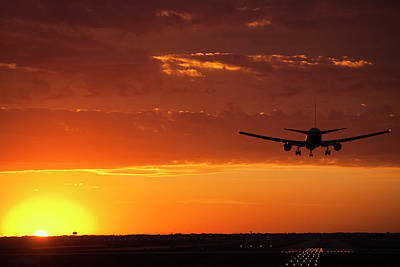 Airliners Photograph - Landing Into The Sunset by Andrew Soundarajan