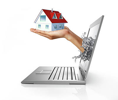 Emergence Photograph - Laptop With Hand Holding Model House by Leonello Calvetti