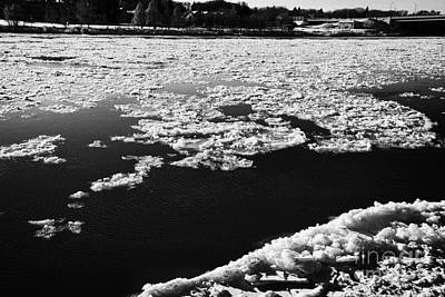 large chunks of floating ice on the south saskatchewan river freezing over in winter Saskatoon Saska Art Print by Joe Fox