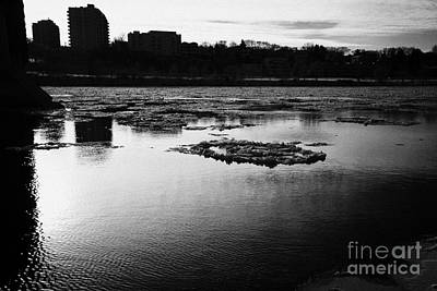 large chunks of floating ice on the south saskatchewan river in winter flowing through downtown Sask Art Print by Joe Fox