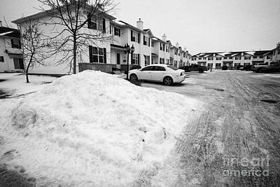 large piles of snow piled up for removal from residential area Saskatoon Saskatchewan Canada Print by Joe Fox