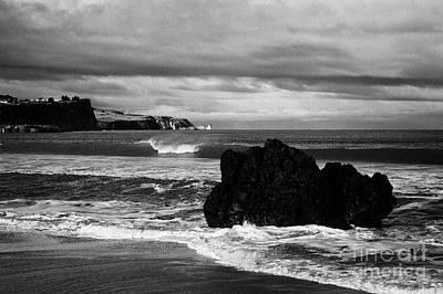 Large Rock On Ballycastle Beach In Winter County Antrim Northern Ireland Art Print by Joe Fox