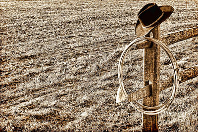 Lasso And Hat On Fence Post Art Print by Olivier Le Queinec