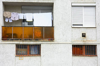 Red Roses - Laundry on balcony by Jan Brons