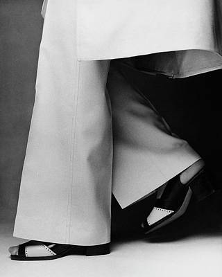 Black And White Photograph - Lauren Hutton's Legs Wearing Calvin Klein Pants by Francesco Scavullo