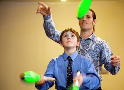 Juggling Photograph - Learning To Juggle by Jim West