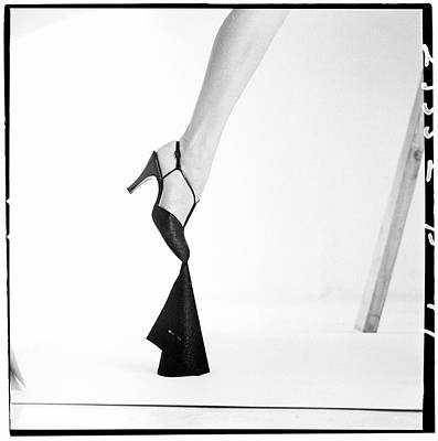 Part Of Photograph - Leg Of A Model Wearing A T-strap Sandal by Richard Rutledge