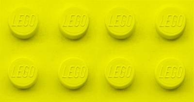 Photograph - Lego Block Yellow by Rob Hans