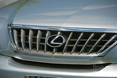 Photograph - Lexus Grill Emblem Close Up by David Zanzinger