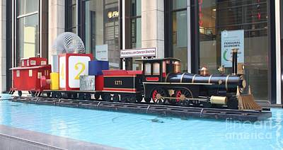 Photograph - Life Size Toy Train Set In Nyc by John Telfer