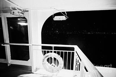 lifebelt on board the hurtigruten ship ms midnatsol at night in winter in Tromso troms Norway Art Print by Joe Fox