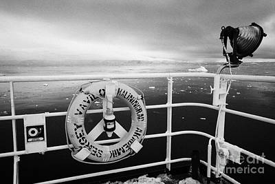 lifebelt on expedition ship covered in snow moored in Fournier Bay on Anvers Island Antarctica Print by Joe Fox