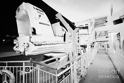 lifeboats and fast launch on board the hurtigruten ship ms midnatsol at night in winter in Tromso tr Art Print