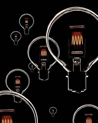 Consumption Photograph - Light Bulbs by Mark Sykes