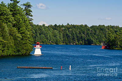 Photograph - Lighthouse And Boathouse by Les Palenik