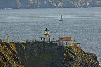 Photograph - Lighthouse And Sailboat by SC Heffner