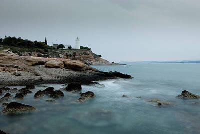 Spetses Photograph - Lighthouse At Dusk With Waves Splashing by Jereme Thaxton