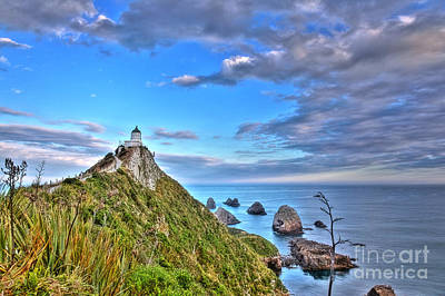 Kim Fearheiley Photography - Lighthouse at nuggetpoint by Fabian Roessler