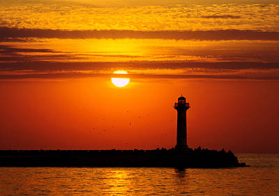 Its A Piece Of Cake - Lighthouse at sunrise by Evgeni Ivanov