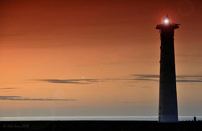 Art Print featuring the photograph Lighthouse At Sunrise by Julis Simo
