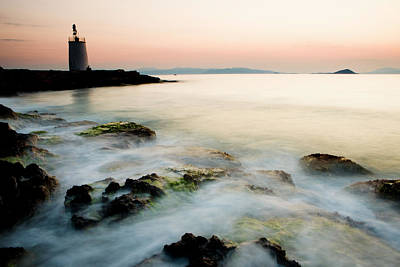Aegina Photograph - Lighthouse At Sunset With Waves by Jereme Thaxton