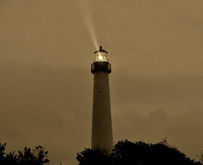 Photograph - Lighthouse In The Storm by Ed Sweeney