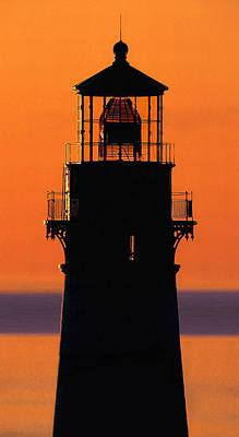 Photograph - Lighthouse On Orange Sky by Herb Paynter