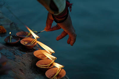 Ganges Photograph - Lighting Flower Lamps By The Ganges by Keren Su