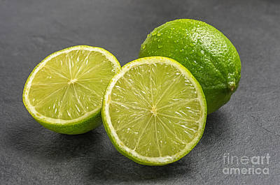 Limes On A Slate Plate Print by Palatia Photo