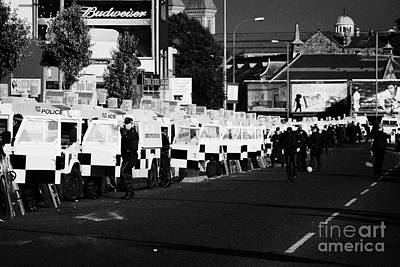 Line Of Psni Land Rovers And Officers On Crumlin Road At Ardoyne Shops Belfast 12th July Art Print by Joe Fox