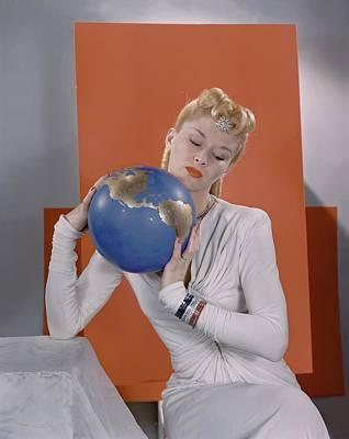 Lisa Fonssagrives Holding A Globe Art Print