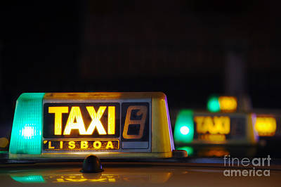 Photograph - Lisbon Taxi Sign by Carlos Caetano