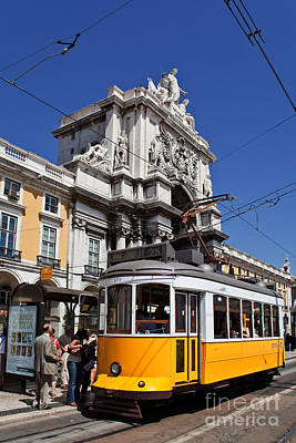 Arch Photograph - Lisbon's Typical Yellow Tram In Commerce Square by Jose Elias - Sofia Pereira