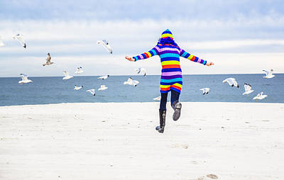 Photograph - Little Girl Runs With Seagulls by Alex Potemkin