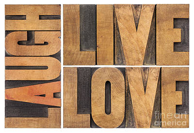 Art Print featuring the photograph Live Love And Laugh In Wood Type by Marek Uliasz