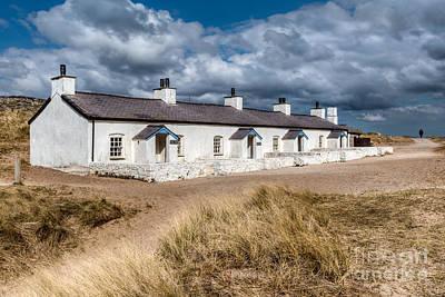 Llanddwyn Cottages Art Print by Adrian Evans