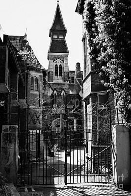 locked gates at old st josephs orphanage building Preston Lancashire UK Art Print by Joe Fox