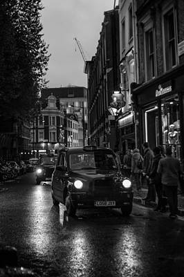 Photograph - London Black Cabs by Alfio Finocchiaro