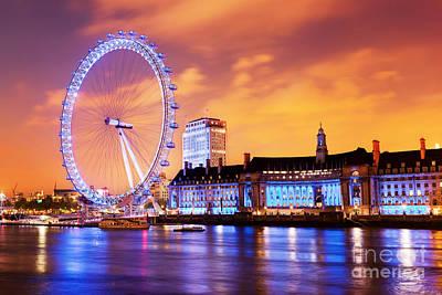Skyline Photograph - London England The Uk Skyline In The Evening London Eye Illuminated by Michal Bednarek