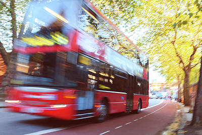 London Red Double Decker Bus Driving At Art Print by Pavliha