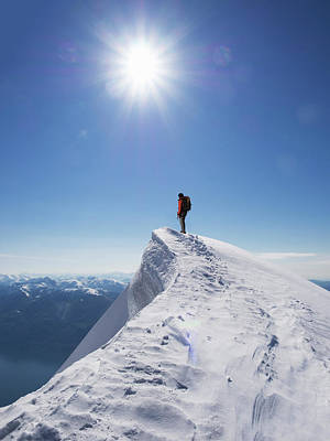 Lone Climber On The Top Of A  Mountain Art Print by Buena Vista Images
