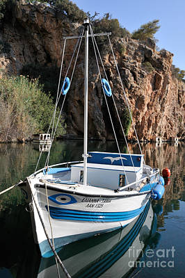 Photograph - Lonely Boat In Agios Nikolaos by George Atsametakis