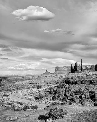 Lonely Cloud And Totem Pole - Monument Valley Tribal Park Arizona Art Print by Silvio Ligutti