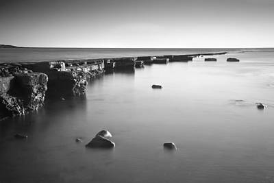 Ledge Photograph - Long Exposure Image Of Tide Going Out Over Rock Ledge During Sun by Matthew Gibson