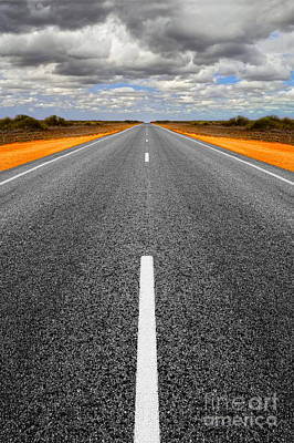 Long Straight Road With Gathering Storm Clouds Art Print