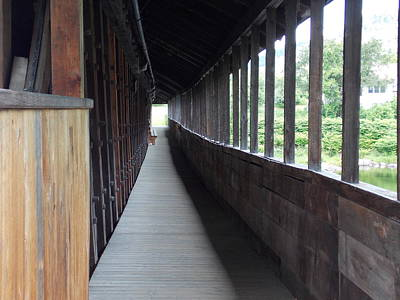 Long Walkway In Covered Bridge Art Print