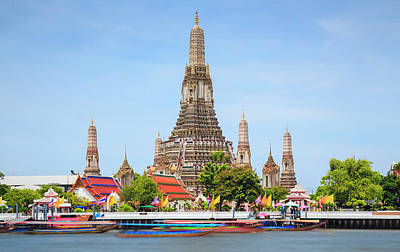 Longtail Wall Art - Photograph - Longtail Boats Pass Wat Arun Temple Of by Ed Norton