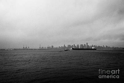 Rainy Day Photograph - looking across Vancouver harbour to vancouver downtown skyline on dull grey rainy day BC Canada by Joe Fox