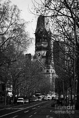 Kudamm Photograph - looking down Kurfurstendamm towards Kaiser Wilhelm Gedachtniskirche memorial church Berlin Germany by Joe Fox
