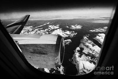 Looking Out Of Aircraft Window Over Snow Covered Fjords And Coastline Of Norway Europe Art Print by Joe Fox